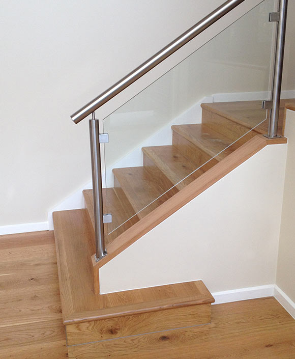 The Balustrading Is Stainless Steel Posts, Handrail And Glass Panel Infill.  The Closed Tread Split Level Staircase Has Been Completed In Blackbutt Also.